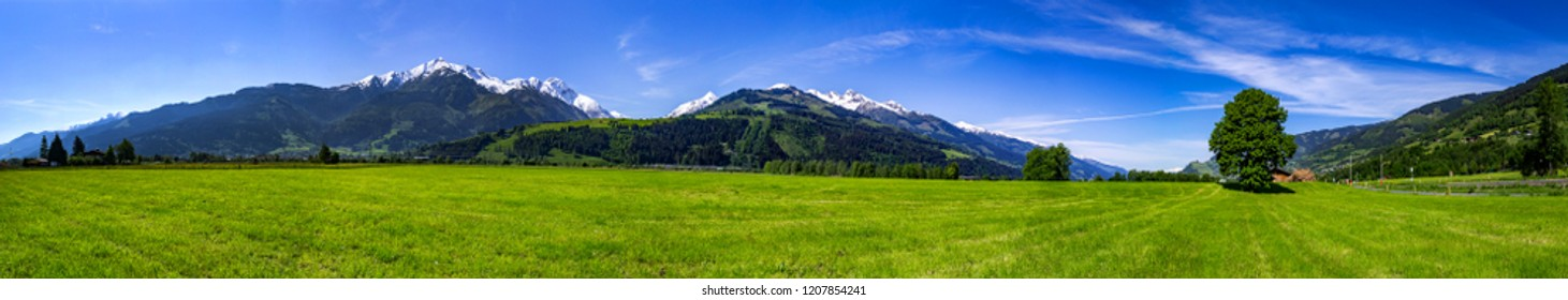 a panorama with mountains, forest and meadow in Austria