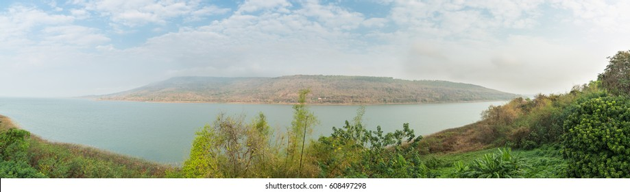 Panorama of Mountains reservoir lake at Lamtakhong Dam Nakhon Ratchasima Province, Thailand, Natural of mountain and dam and blue sky