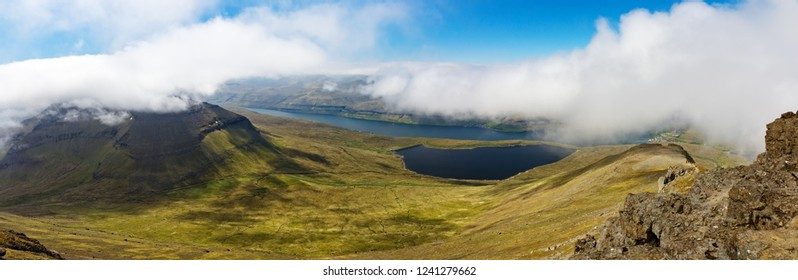 Panorama of mountains and seashore in sunny day  from Slættaratindur  the highest point in the Faroe Islands, Denmark