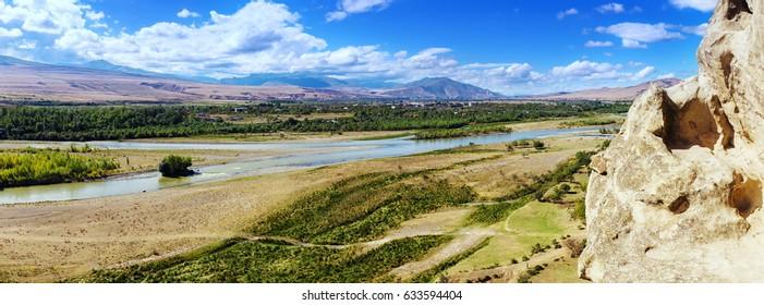 Panorama of  Mtkvari River, Georgia from ancient rock-hewn town Uplistsikhe.