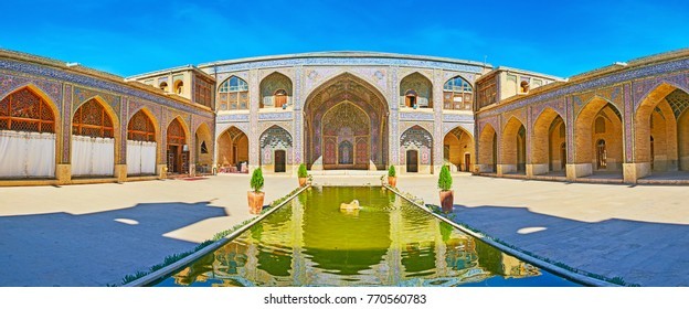 Panorama of  Nasir Ol-Molk mosque with elegant tiled decorations and fountain in the middle, Shiraz, Iran.