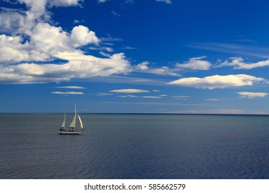 Panorama of nature, Spain, sea shore and a boat sailing in the Mediterranean sea, beautiful clouds