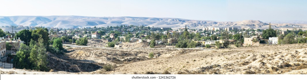 panorama of a neighborhood in Arad Israel on a clear fall day with desert mountains and bedouin villages in the background