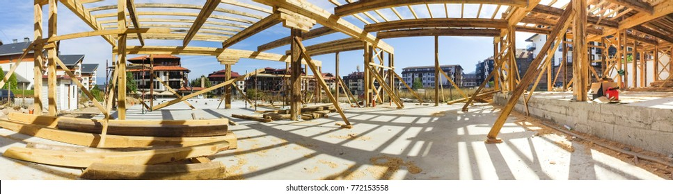 Panorama of new framed construction of a house building from the ground up