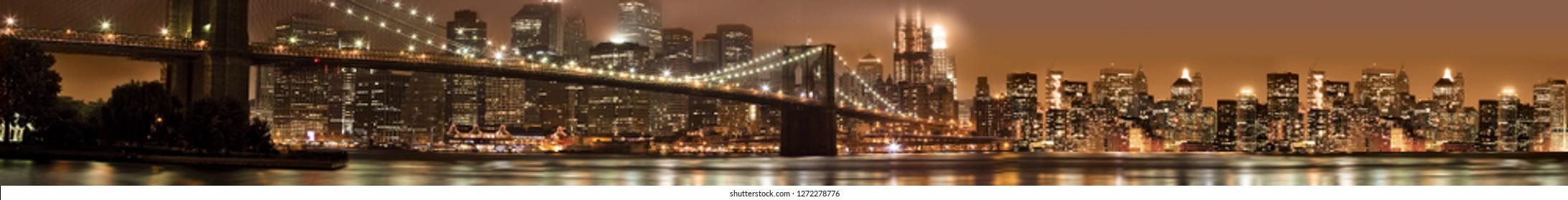 Panorama of New York City Manhattan. Brooklyn Bridge at night. Horizontal view for a glass panels (skinali).