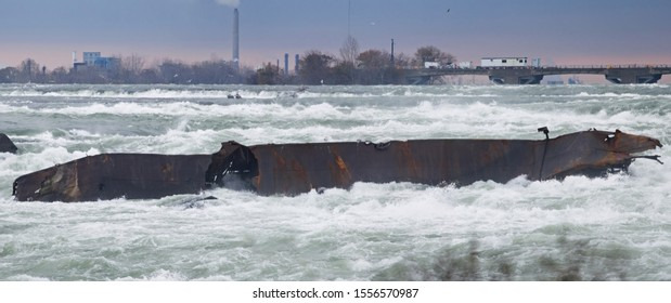 Panorama from Niagara Falls, Ontario, Canada shoreline of the barge in the Niagara River for over 100 years in its new position where it moved to when it dislodged in a Halloween storm October 2019.