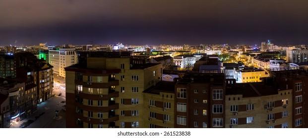 Panorama of night city lights. Tyumen city, Russia