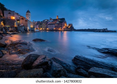 Panorama of night fishing village Vernazza with Santa Margherita Church and lookout tower, Cinque Terre, Italy