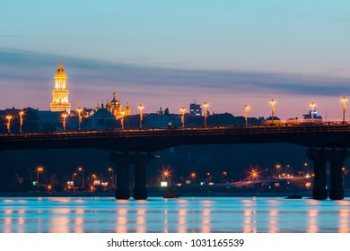 Panorama at night Kiev with Kiev Pechersk Lavra. The sunset sky and shine of the cityscape over the river Dnipro.Ukraine. Kiev.