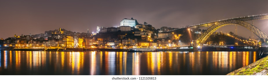 Panorama of night Porto cityscape with reflection in water, Portugal, Europe