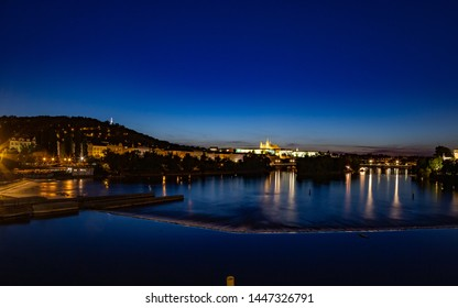 Panorama of night Prague with Prague Castle and river Vltava. Night cityscape