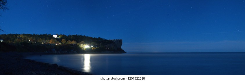 Panorama of the night sky at a limestone beach, Gotland Sweden