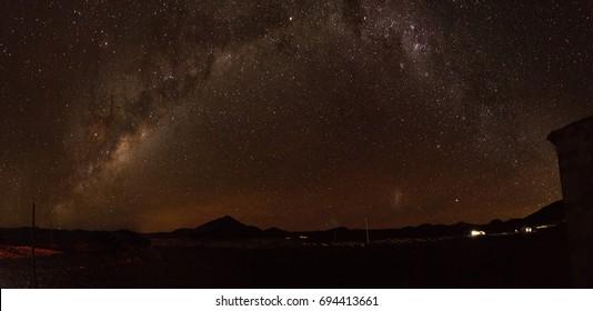 Panorama of night sky in the Uyuni Desert in Bolivia