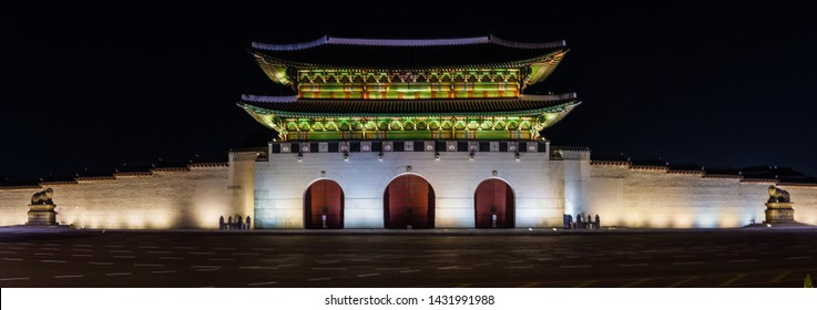 Panorama night time image of the Gwanghwamun Gate in the Gyeongbokgung Palace complex in Seoul, South Korea.