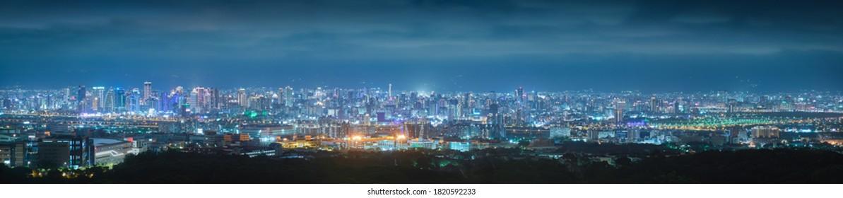 Panorama night view of Taichung City - Asia business city concept image, panoramic modern metropolis bird's eye view at evening, shot in Wanggaoliao Night View Park, Taichung, Taiwan.