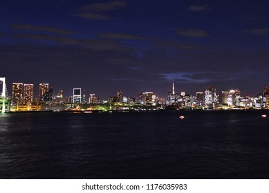 Panorama night view of Tokyo Bay with cityscape at night. Tokyo, Japan.