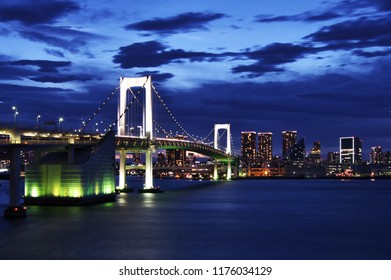 Panorama night view of Tokyo Rainbow bridge and Tokyo Bay with cityscape at night, Tokyo, Japan.