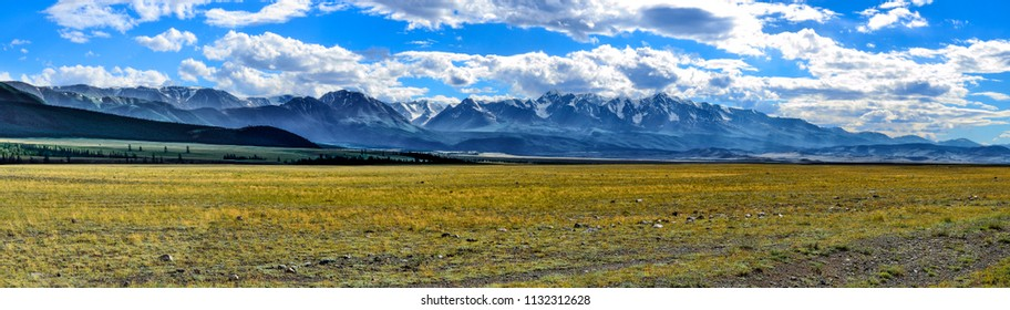 Panorama of North-Chuya ridge or Severo-Chuiskii range - chain of mountains in Altai republic, Russia - summer mountain landscape with Kuray Steppe at foreground