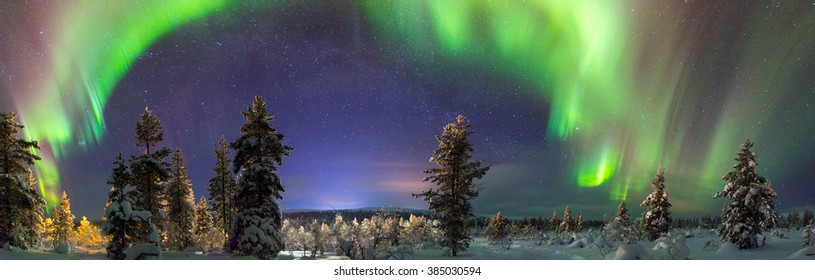 Panorama of northern lights over Lapland, Finland.