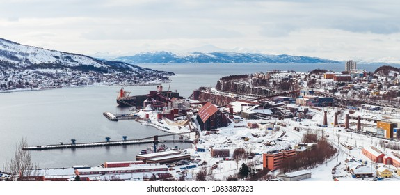 Panorama Norway Narvik, view of the city and the bay, with one ship being loaded up at the iron ore plant, a winter day