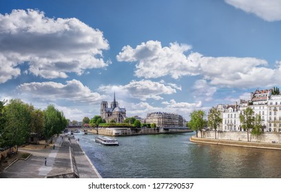 Panorama with Notre Dame cathedral and boat on Seine in Paris, France