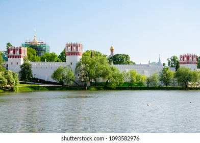Panorama of the Novodevichy Convent, also Bogoroditse-Smolensky Monastery from the pond in Moscow , Russia.