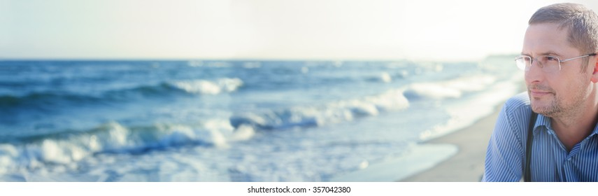 panorama ocean panoramic view man thinking or meditating portrait selective focus