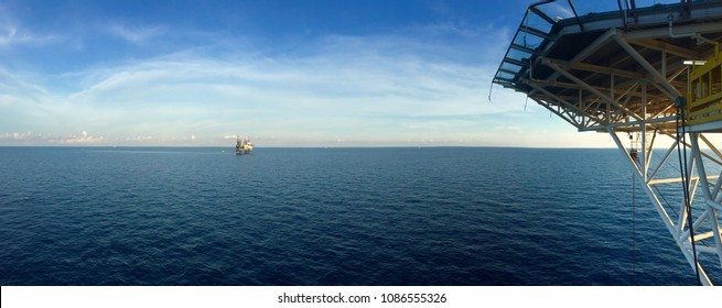 Panorama of Offshore Jack Up Oil Drilling Rig and The Production Platform