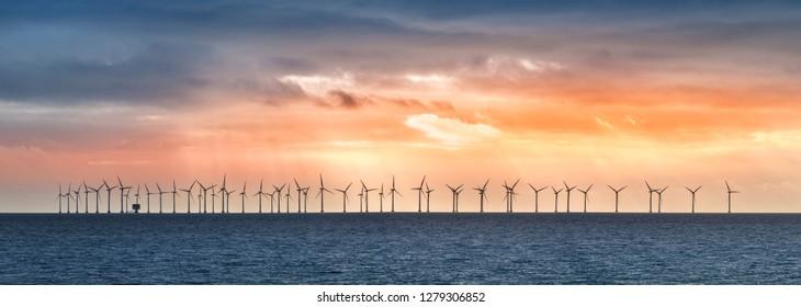 Panorama of Offshore Wind Turbines in cloudy weather near Copenhagen, Denmark