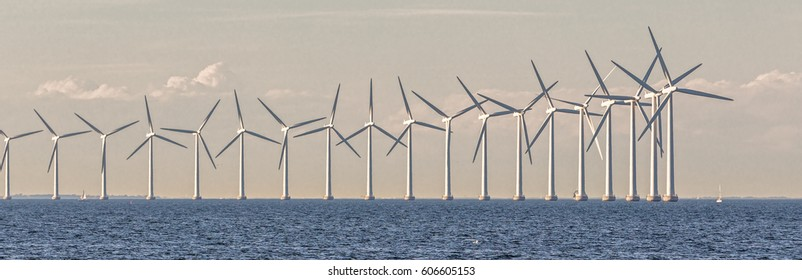 Panorama of Offshore Wind Turbines in cloudy weather near Copenhagen, Denmark