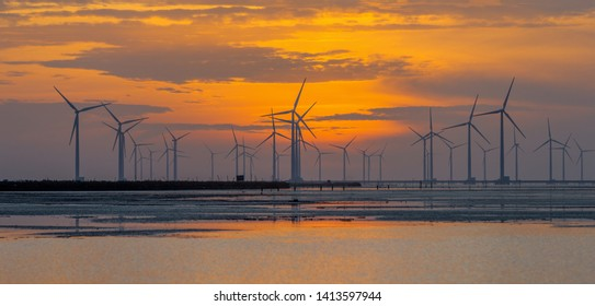 Panorama of Offshore Wind Turbines near Bac Lieu city in South Vietnam at low tide. Nha Mat village. Morning view