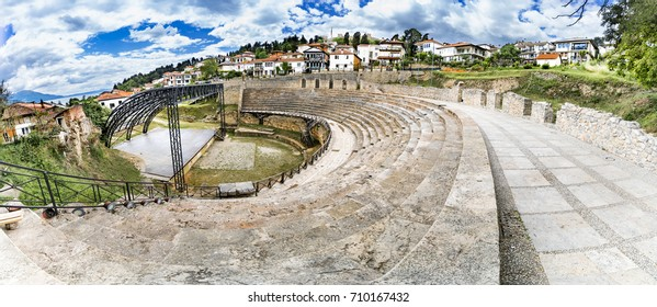 Panorama of Ohrid - Macedonia. The antique ancient greek amphitheater or antique theatre of Ohrid with view on old town of Ohrid and Lake Ohrid in Macedonia