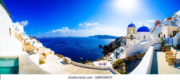 Panorama of Oia. Blue domes  and aegean sea.Santorini.Greece