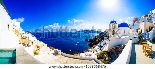 Panorama of Oia. Blue domes  and aegean sea.Santorini.Greece