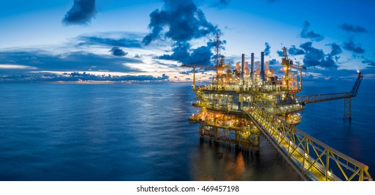 Panorama of Oil and Gas central processing platform in twilight, offshore hard work occupation twenty four working hours.