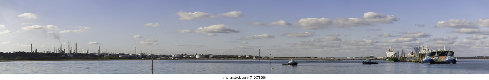 Panorama of an oil refinery on a sunny day.