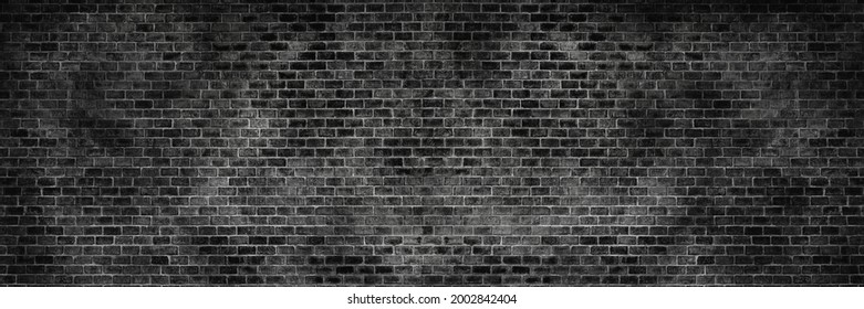 Panorama old black brick texture detail background. House, shop, cafe and office design backdrop. Paint brickwork wall and copy space.