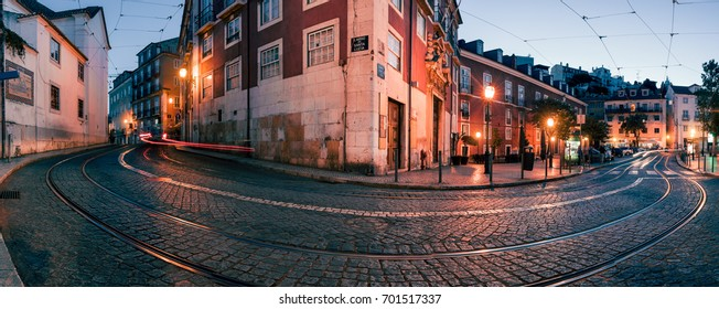 Panorama of old European city street at night, Lisbon, Portugal