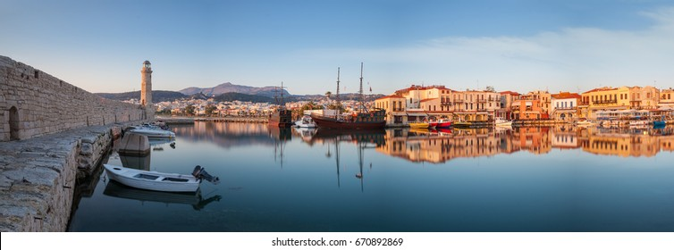 Panorama of old harbour in Rethymnon with lighthouse at sunrise Crete, Greece