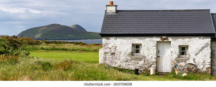Panorama of old irish cottage on the Dingle peninsula, View of great Blasket Island in the background.