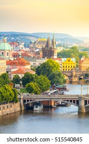 Panorama of the old part of Prague from the Letna park. Beautiful view on the bridges over the river Vltava at sunset. Old Town architecture, Czech Republic.