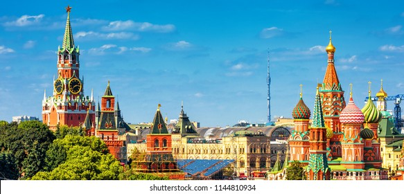 Panorama of the old Red Square with Moscow Kremlin and St Basil's Cathedral in summer, Moscow, Russia. It are the best-known sights of Moscow. Beautiful panoramic view of the heart of sunny Moscow.