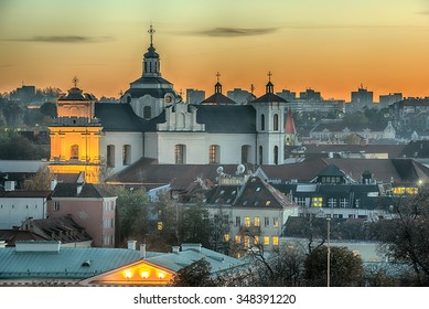 Panorama of Old Town in Vilnius, Lithuania: Roman Catholic Church of Holy Spirit in the beautiful Sunset of autumn