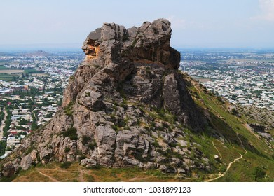 Panorama of Osh town from Sulaiman-Too montain. The rock Suleiman-too. Kyrgyzstan.