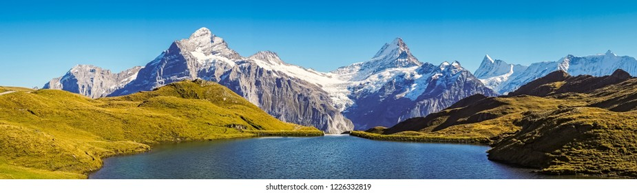 Panorama over the Bachalpsee during the famous hiking trail from First to Grindelwald (Bernese Alps, Switzerland). You can have great views on mountains like the Eiger, Monch and Jungfrau.