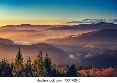 panorama over misty Gorce to snowy Tatra mountains in the morning, Poland landscape