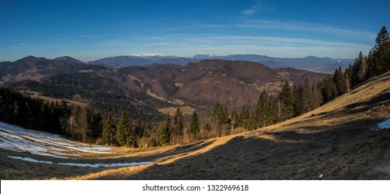 Panorama over valley looking towards the kamnik and savinja alps in slovenia, down from the hill of Mrzlica.