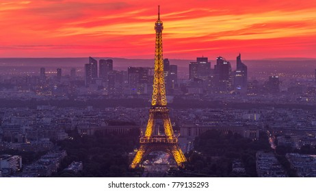Panorama of Paris after sunset day to night transition timelapse. Eiffel tower view from observation deck of montparnasse building in Paris - France. Colorful sky at summer day
