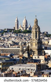 Panorama of Paris: The Sainte-Trinite and Sacre-Coeur churches.View of Paris from the rooftop of building into the summer sunset.  Paris, France