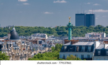 Panorama of Paris timelapse with Bastille column. View from observation deck of Arab World Institute (Institut du Monde Arabe) building. Top aerial view. Green trees, Seine river, Blue cloudy sky at